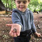Boy holding a slug