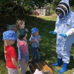Beekeeper with children