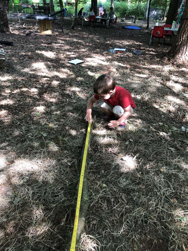 Boy using a tape measure