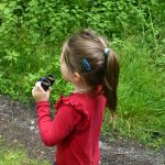 Girl using binoculars